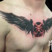 Szárnyas koponya tetoválás